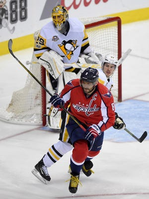 Washington Capitals left wing Alex Ovechkin (8) skates next to Pittsburgh Penguins center Sidney Crosby (87) and goalie Marc-Andre Fleury (29) during the third period of Game 1.