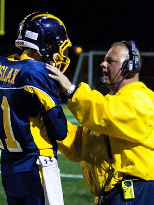 Kettle Moraine athletic director Mike Fink, right, also served as the Lasers football coach during his tenure.