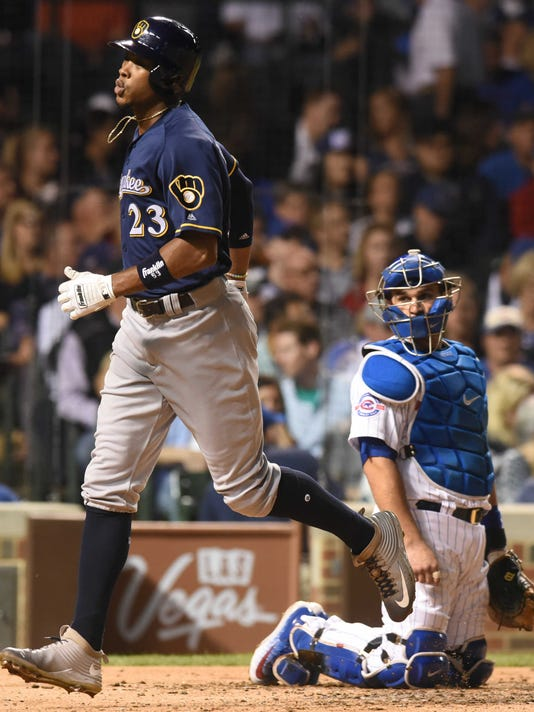 Chicago Cubs catcher Miguel Montero watches Milwaukee Brewers' Keon Broxton cross the plate after Broxton hit a fourth-inning home run during a baseball game Thursday, Sept. 15, 2016, in Chicago. The Brewers won 5-4. (Joe Lewnard/Daily Herald via AP)