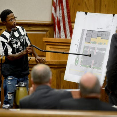 Demarcus Triplett points to a map depicting the Omni