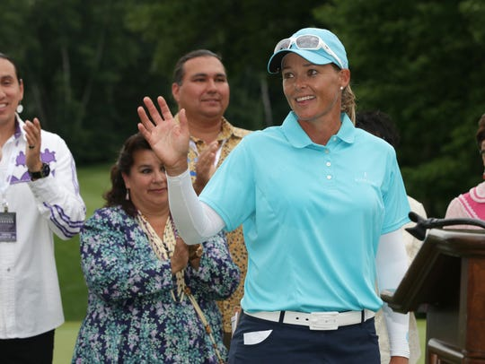 Katherine Kirk waves to golf fans following her win at the LPGA Classic at Thornberry Creek on July 9, 2017.