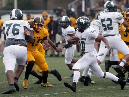 Detroit Cass Tech quarterback Aaron Jackson scrambles