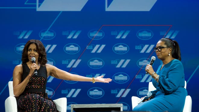In this  June 14, 2016, file photo, first lady Michelle Obama and Oprah Winfrey have a discussion on Trailblazing the Path for the Next Generation of Women during the White House Summit on the United State of Women in Washington. Mrs. Obama sat down in The White House with Winfrey for a White House interview that was broadcast on CBS Dec. 19, 2016.