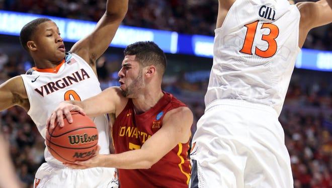 Iowa State's Georges Niang (31) drives to the hoop as Virginia's Devon Hall and Anthony Gill defend during their NCAA Tournament game on Friday.