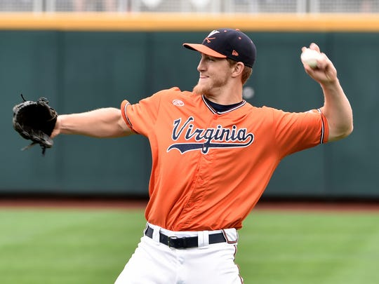 Virginia outfielder Joe McCarthy throws during practice at TD Ameritrade Park in Omaha, Neb., on Friday