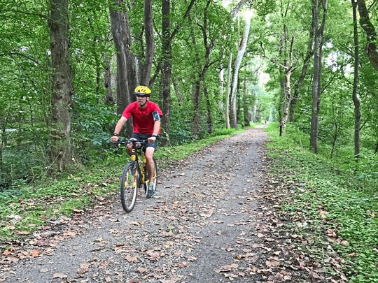 A cyclist rides on the C&O Canal Towpath between Harpers Ferry and Sheperdstown, W. Va.