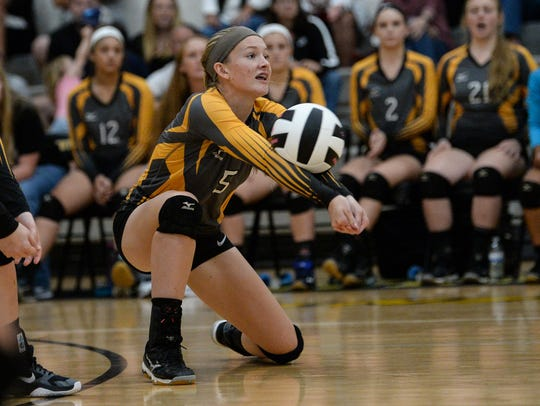 Crescent sophomore Kamryn Dove(5) bumps a ball against
