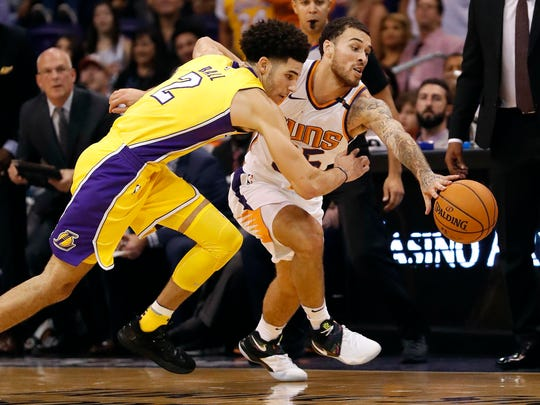 Suns guard Mike James steals the ball from Lakers guard