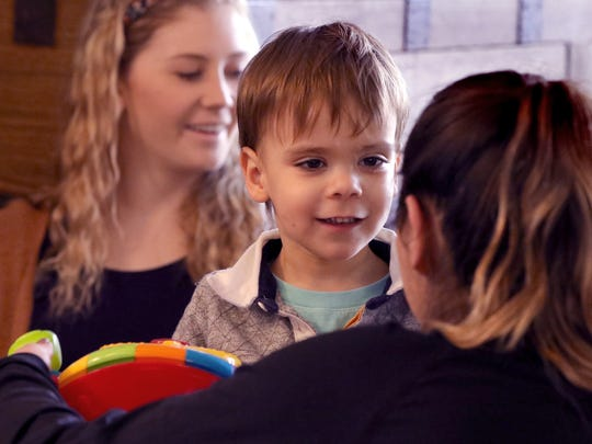 James Crimmins, 3, works with Kristin Gendreau, a UW-Milwaukee student and therapy technician, as part of his home therapy for his autism to prepare him to attend school with his peers.