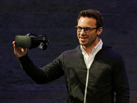 Oculus CEO Brendan Iribe holds up the new Rift virtual
