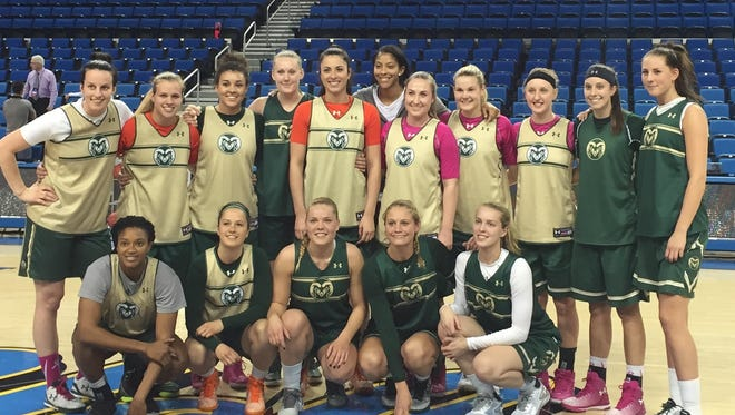The CSU women's basketball team with WNBA legend Candace Parker, middle behind back row, before practice at Pauley Pavilion on Friday.