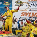 Joey Logano celebrates his win today on the NASCAR Sprint Car series.