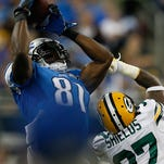 Lions wide receiver Calvin Johnson makes a catch over the Packers' Sam Shields during Sunday's game at Ford Field.
