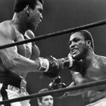 Boxer Muhammad Ali and Joe Frazier slugged it out in New York on Jan. 28, 1974.