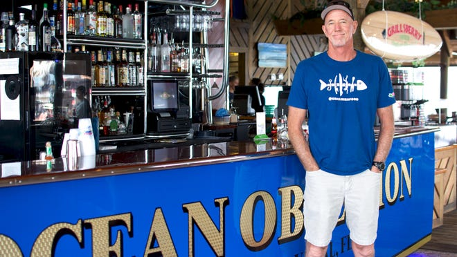 Joe Penovich, owner of Grills Seafood Deck & Tiki Bar restaurants, shows off the the new bar, modeled after his boat, at the Port Canaveral location.
