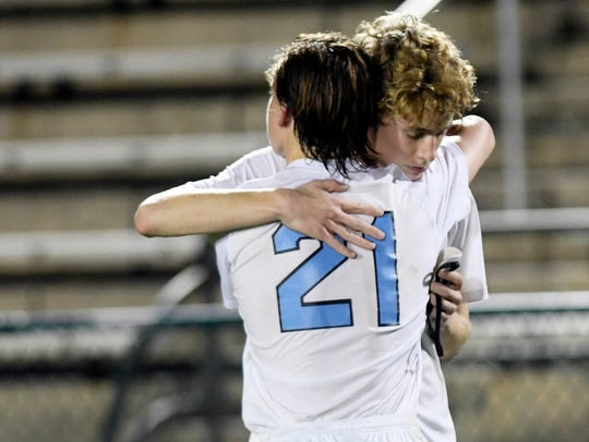 Bayce Valveri and Beecher Lewis of Maclay hug after