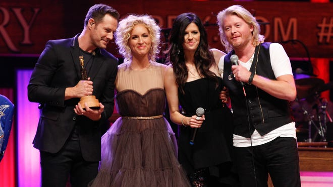 From left, Jimi Westbrook,Kimberly Schlapman,Karen Fairchild and Philip Sweet of Little Big Town are inducted into the Grand Ole Opry on October in Nashville, Tenn.