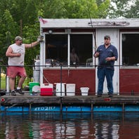 They love fishing, so they set cabins afloat: Wolf River rafts are 'home' to some anglers