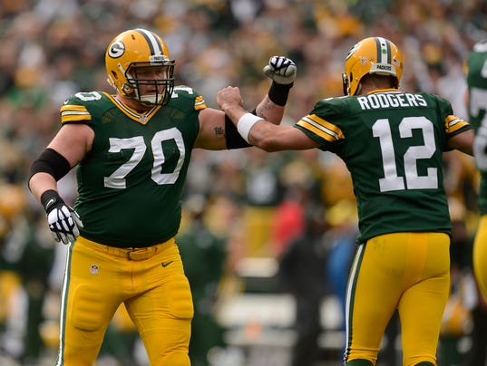 Aaron Rodgers, T.J. Lang