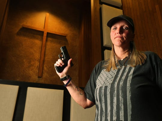 Connie Peterson stands inside the Salt Lake Christian Center where she attends church in Millcreek on Wednesday, Aug. 1, 2018. Peterson has a concealed gun during worship.