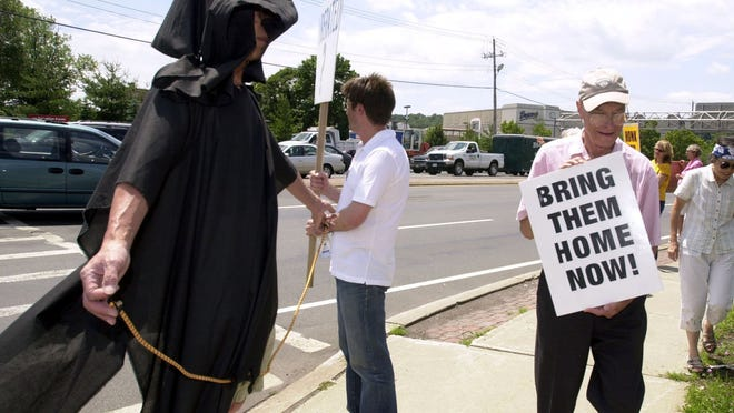Palisades' Albon Man, right, takes part in a protest in Nanuet in 2004. Man had a lifelong commitment to peace and love of all people.