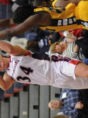 Morgan Griffith (34) takes the ball to the basket for Shippensburg University's women's basketball team. The Lady Raiders are riding a 10-game winning streak, while the SU men have won seven straight games.