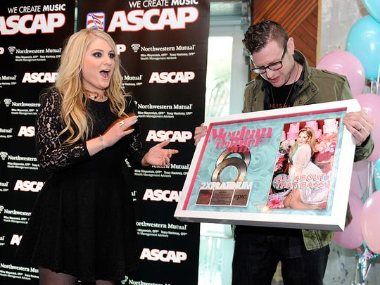 Meghan Trainor celebrates with songwriter Kevin Kadish