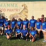Baptist Health Care volunteers planted flower beds at Manna Food Pantries, among other contributions, during United Way's Day of Caring.