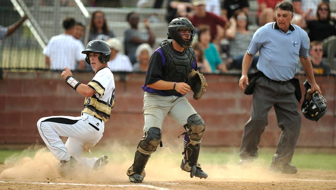 Abilene High's Doak Holloway (26) scores a run on a squeeze bunt during the bottom of the fourth inning of the Eagles' 7-3 win over Keller Timber Creek on Friday, April 28, 2017, at AHS's Blackburn Field.