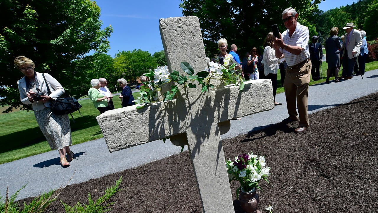 Questers Falling Spring Chapter, a historical preservation group, restored the cast-stone cross at Emmanuel Chapel on Penn State's Mont Alto campus.