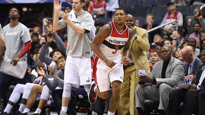 Washington Wizards guard Bradley Beal runs up the court after making a three point shot.