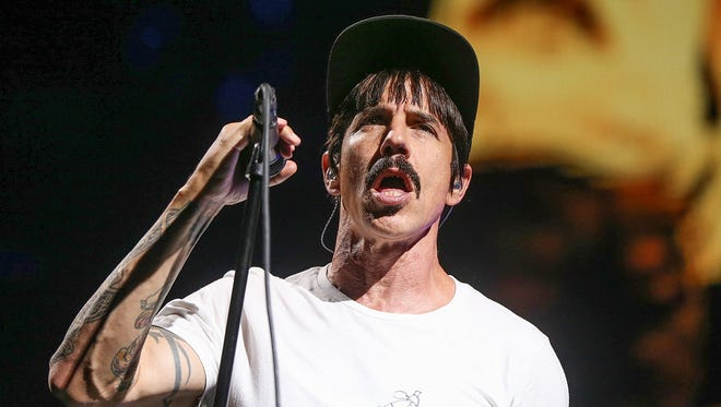 Singer Anthony Kiedis performs with the Red Hot Chili Peppers Thursday at Bankers Life Fieldhouse.