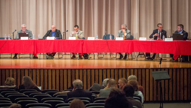 Members of the Distressed Unit Appeals Board listen to the public and members of the Muncie Community School administration speak at a forum on Nov. 13 inside the Northside Middle School. The DUAB will decide to keep or terminate the need for an emergency manager in the district come December.