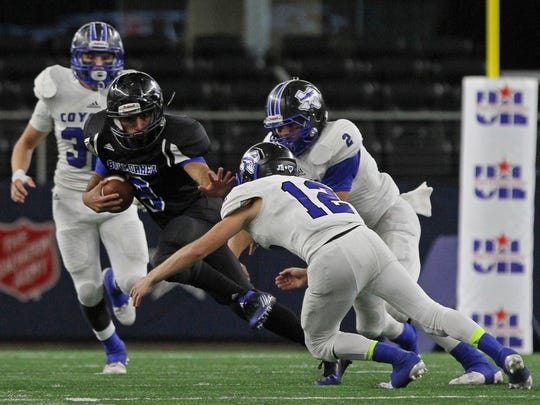 Balmorhea Bears' Kyle Garcia(9) runs for a large gain as Richland Springs Coyotes' Brandon Tharp (12) and Hutton Lusty (2) attempt a tackle during the second quarter of the UIL Class 1A Division II state championship Wednesday, Dec. 14, 2016, in Arlington.