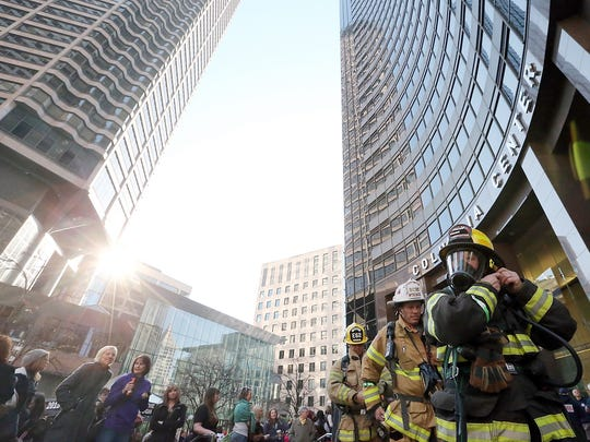 Poulsbo firefighter Juanitta Lang (right) tightens her helmet as she heads for the start of the Scott Firefighter Stairclimb up the Columbia Center in Seattle on Sunday, March 8, 2015.