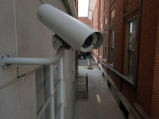 Security cameras mounted on the building watches activities around the Franklin County Courthouse.