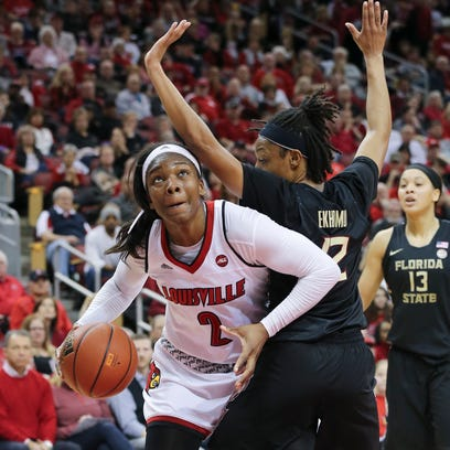 U of L's MyishaHines-Allen (2) looks for room to operate