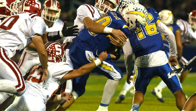 Philo's Cole Smith fights for yardage against Sheridan Friday night in Duncan Falls.