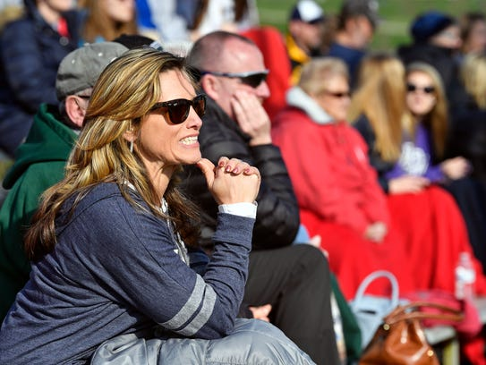 Jeanie Parker watches the ball after son Nick Parker