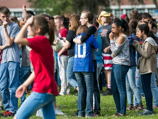 Forest High School students console one another after