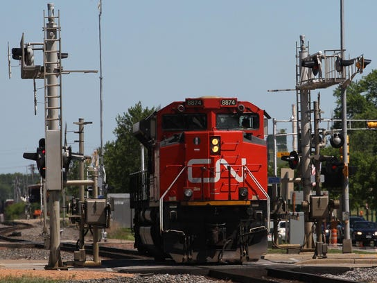 A Canadian National locomotive goes through the crossing