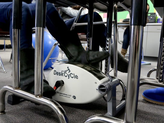 A student in Amy Akey's math class peddles using a