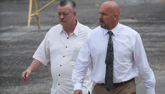 Clifford Shoemake, left, and Kimberly Conner, part owners of Guam Medical Transport, arrive for an arraignment hearing at the U.S. District Court of Guam in Anigua on Jan. 26, 2016. The owners are accused of billing insurance companies millions of dollars for ambulance services that did not warrant insurance coverage.
