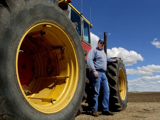 Farmer with big tractor