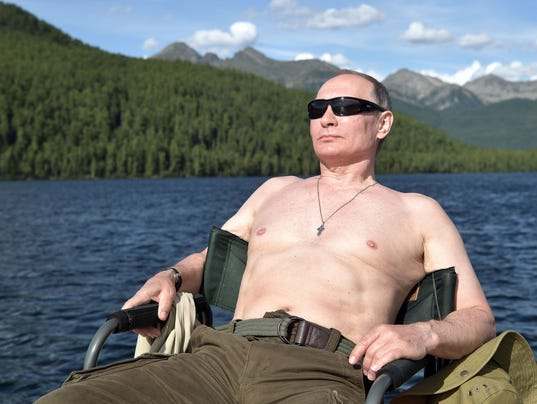 850816ed3ff abcnews.go.com Shirtless Vladimir Putin fishes, dives and swims during  Siberian vacation
