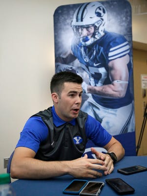 BYU quarterback Tanner Mangum speaks with reporters during BYU's Football Media Day Thursday.