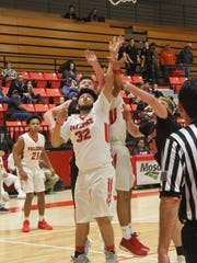 Junior Josiah Leija goes for a rebound during Saturday's