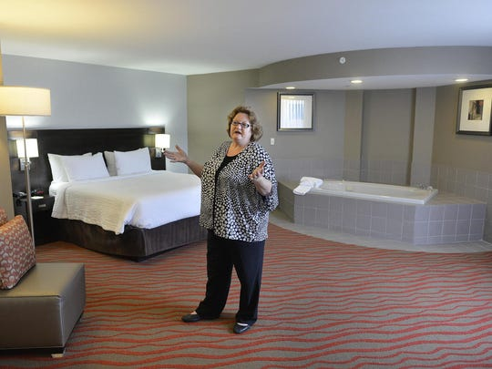 Chriss Wohlleber, general manager of the Courtyard by Marriott St. Cloud, talks July 17 about the bridal suite she's in and the remodeling and rebranding the former Le St-Germain Suite Hotel went through.