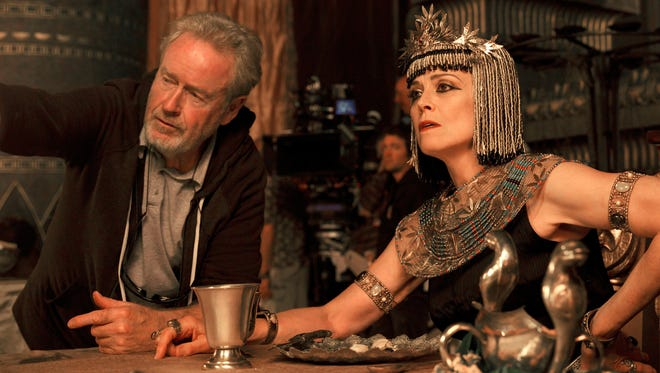 "This image released by 20th Century Fox shows director Ridley Scott, left, and actress Sigourney Weaver on the set of ""Exodus: Gods and Kings."" ""Exodus,"" opening Dec. 12, 2014, stars Bale as Moses, Edgerton as pharaoh-to-be Ramses, John Turturro as the Egyptian leader and Weaver as his queen. (AP Photo/20th Century Fox, Kerry Brown)"