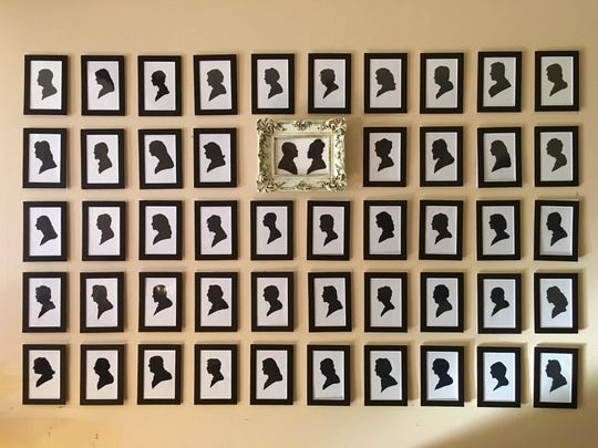 This wall at Jody and Ben Hale's house is filled with silhouettes of guests at their wedding.